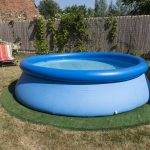 blue rubber pool on the grass for children